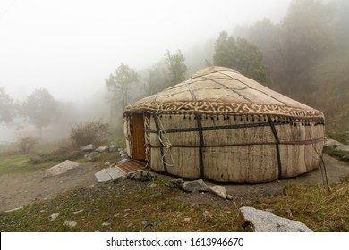A traditional kyrgyz yurta tent in the countryside mountain, with the morning fog