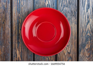 Traditional lacquer ceramic red plate on the desk