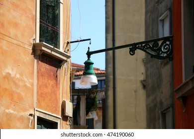 Traditional lamp on the picturesque street in Venice, Italy. Selective focus.