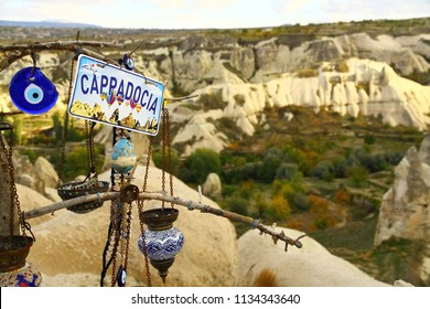 Traditional lamps and blue beads with Cappadocia view. The sign says ''Turkiye Cappadocia'' means ''Turkey Cappadocia''.