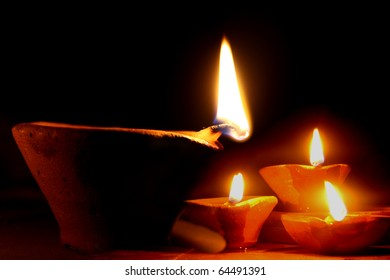 Traditional lamps lit on the occassion of Diwali - The Festival of Lights in India.