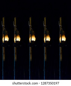 Traditional lanterns hanging on the bamboo sticks at night