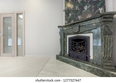 Traditional large marble fireplace close up in a empty living room