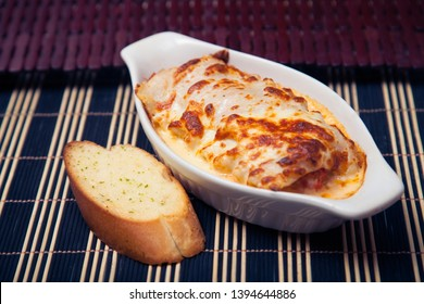 Traditional lasagna made with minced chicken bolognese sauce topped with cheese bread.
