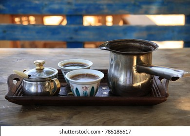 A traditional Lebanese breakfast setting with a Turkish coffee tray and hot coffee cups.