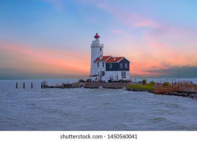 Traditional lighthouse 'Het Paard van Marken' in Marken the Netherlands at sunset
