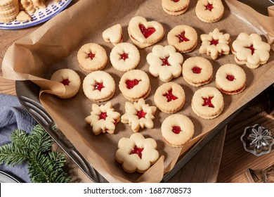 Traditional Linzer Christmas cookies filled with marmalade