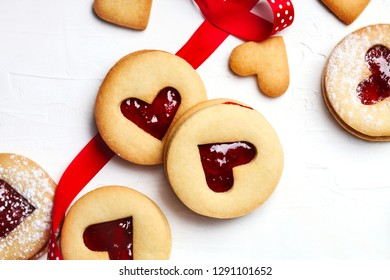 Traditional Linzer cookie with strawberry jam, top view. Valentine's day concept