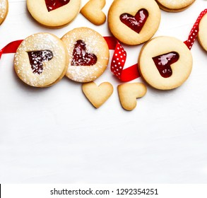 Traditional Linzer cookie with strawberry jam, top view, copy space. Valentine's day concept