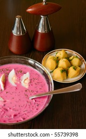 traditional lithuanian cold borscht with beet and eggs, served with hot potatoes