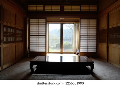 Traditional living room of Japan with washi paper door and wood carving frame.