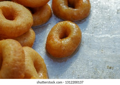 Traditional Lokma dessert from Turkey. Lokma is a Turkish fried sweet dough covered in a syrup and served as a dessert or as a popular coffee accompaniment. Close-up.