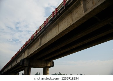 A traditional long concrete made highway bridge