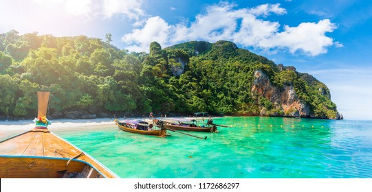 Traditional long tail boat on famous Monkey beach, Phi Phi Islands, Thailand