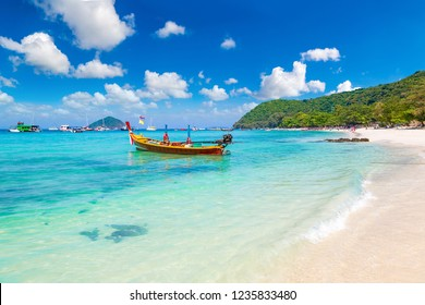 Traditional long tail boat on Coral (Ko He) island near Phuket island, Thailand in a summer day