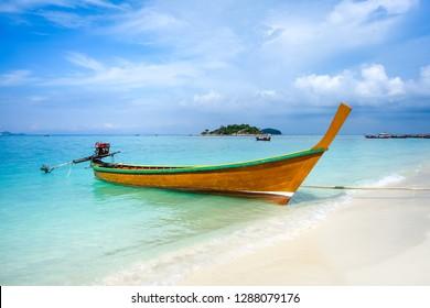 Traditional long tail boat on sunrise beach, Koh Lipe, Thailand