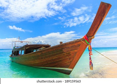 Traditional long tail boat on a beach in Thailand