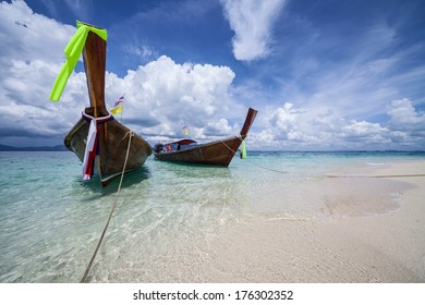 Traditional long tail boats in a clear water of Andaman sea, Thailand