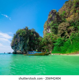 Traditional longtail boats near tropical island, Thailand