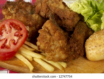 Traditional lunch with chicken wings, fries and salad