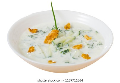 Traditional Macedonian cold vegetable soup Tarator with cucumber, walnuts, garlic and yogurt.  Isolated over white background