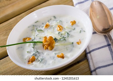 Traditional Macedonian cold vegetable soup Tarator with cucumber, walnuts, garlic and yogurt