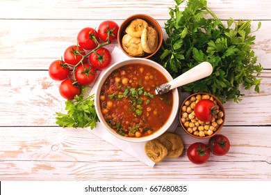 Traditional Maghreb, Moroccan and Algerian tomato soup Harira and ingredients. Served with figs. Ramadan food. Traditional Jewish cuisine