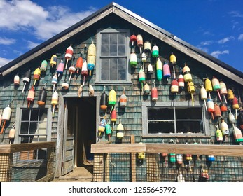 Traditional Maine lobster shack with lobster cage buoys adorning its exterior, in Bar Harbor, Maine.