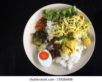 Traditional Malay food in a plate isolated on black background
