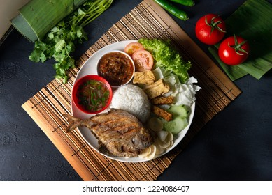 traditional malay indonesian fried pomfret fish rice