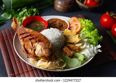 traditional malay indonesian tilapia fish rice