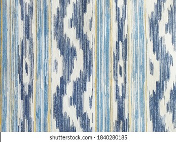 "Traditional Mallorcan fabric texture with a pattern in the shape of blue and white tongues. Cushion fabric background made with natural fiber and bluish tint. ""IKAT"", typical majorcan fabric pattern."