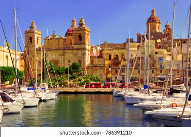 Traditional Maltese architecture and yachts in the harbour of Valletta, Malta