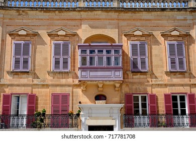 Traditional Maltese building with lilac coloured shutters in the old town, Mdina, Malta, Europe.