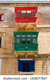 The traditional Maltese colorful wooden balconies in Valletta, Malta