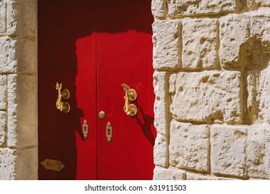 Traditional maltese door with gold dolphin door knockers