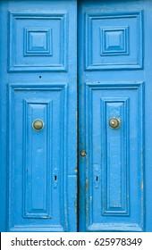 traditional maltese doors. Vintage blue doors.Open door.  Colorful architecture in Malta. Exterior. House decor in Malta.