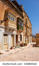 A traditional Maltese townhouses (maisonnette) with colorful balconies (gallerija) in Birgu, Malta