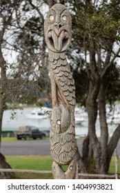 Traditional Maori carved post with a face. At Waitangi, Northland, New Zealand.