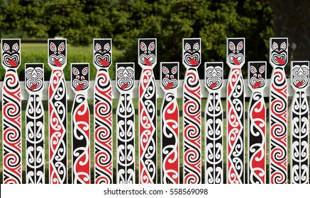 Traditional Maori carving at Whakarewarewa marae (meeting ground) in Rotorua, New Zealand. Maori art detail photo. Maori culture