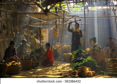 Traditional Market under the Ray of Light in the Outskirts of Jakarta, Indonesia. Date taken 14 October 2013