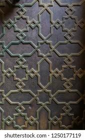 Traditional maroccan ornate metal door pattern background