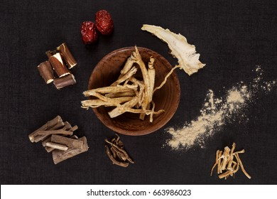 Traditional medical herbs from asia, alternative medicine. Aswagadha, ginseng, raisin tre, jujube. Adaptogen background.