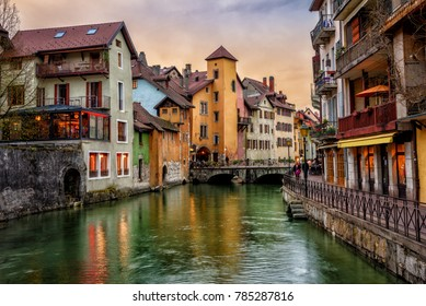 Traditional medieval houses on a Thiou river in historical Old Town of Annecy, Savoy, France, in dramatic sunset light