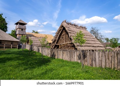 Traditional medieval wooden buildings at archaeological heritage village near Velehrad Monastery, Modra, Moravia, Czech Republic, sunny summer day - Shutterstock ID 1669977901