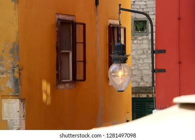 Traditional Mediterranean architecture in Sibenik, Croatia. Colorful houses and vintage lamp. Sibenik is popular summe travel destination.