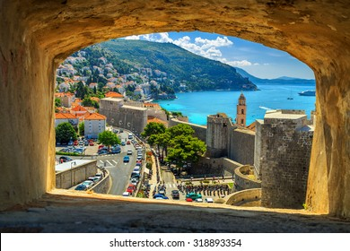 Traditional Mediterranean houses with red tiled roofs and Dubrovnik fortress bastions,Dalmatia,Croatia,Europe