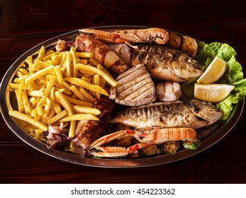 Traditional Mediterranean seafood plate on the wooden background
