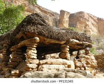 Traditional  meeting house in the West African nation of Mali. Stone pillars support a thick roof that is thatched with millet straw.