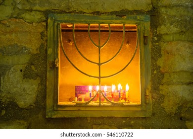 Traditional Menorah (Hanukkah Lamp), in the Jewish quarter, Jerusalem Old City, Israel. Text is: These candles are sacred